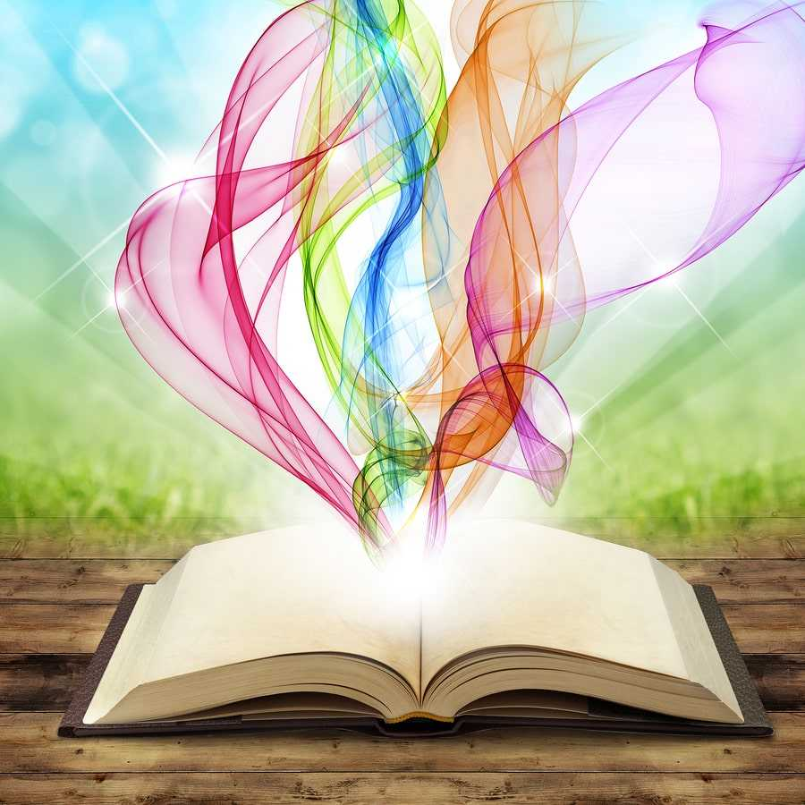 open book with colored smoke swirls and twirls